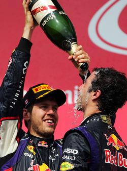 Race winner Daniel Ricciardo, Red Bull Racing celebrates with team mate Sebastian Vettel, Red Bull Racing on the podium