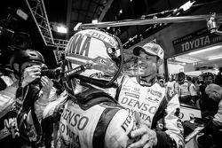 Pole winner Kazuki Nakajima celebrates with teammate Alexander Wurz