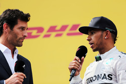 Second placed Lewis Hamilton, Mercedes AMG F1 on the podium with Mark Webber, Porsche Team WEC Driver