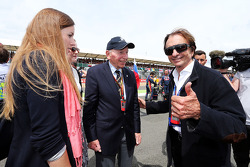 John Surtees, with Emerson Fittipaldi, on the grid