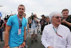 Lukas Podolski, Football Player on the grid with Bernie Ecclestone