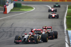 Romain Grosjean, Lotus F1 E22 leads team mate Pastor Maldonado, Lotus F1 E21