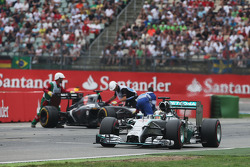 F1: Lewis Hamilton passes Adrian Sutil, who spun and retired from the race