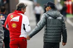 (L to R): Marco Mattiacci, Ferrari Team Principal with Lewis Hamilton, Mercedes AMG F1