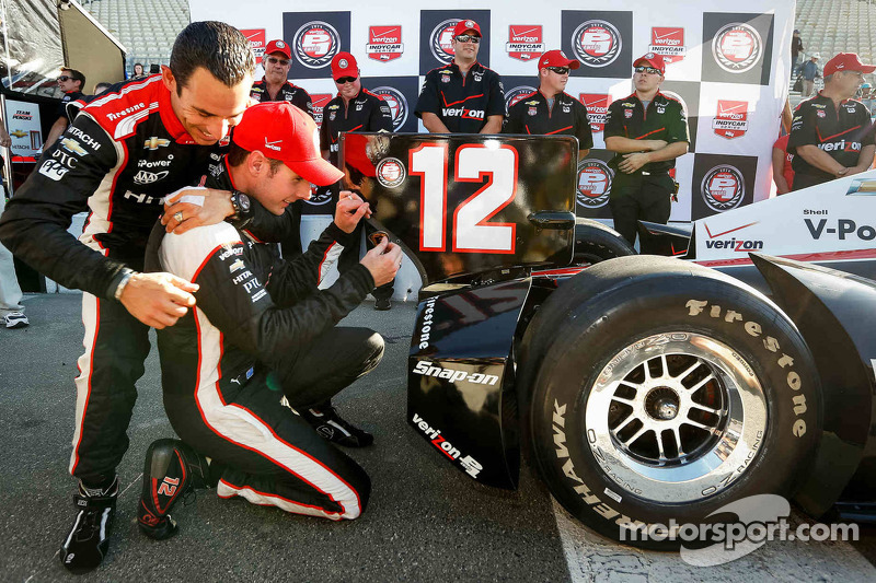 Polesitter Will Power, Team Penske Chevrolet is congratulated by teammate Helio Castroneves
