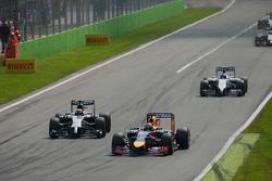 Sebastian Vettel, Red Bull Racing RB10 leads Kevin Magnussen, McLaren MP4-29