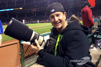 Kurt Busch photographs a Chicago Cubs baseball game