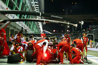 Kimi Raikkonen, Ferrari F14-T practies a pit stop