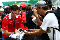 Alexander Rossi, Marussia F1 Team Reserve Driver signs autographs for the fans