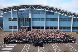 Lewis Hamilton and Nico Rosberg and Mercedes factory workers pose for a group photo