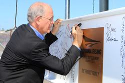 Jim France signs the beam