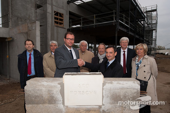 Marc Ouayoun, General Manager of Porsche France, and Pierre Fillon, President of the Automobile Club de l'Ouest, laid the first stone of the Porsche Experience Centre inside the Le Mans circuit.