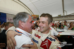 2004 WRC champion Sébastien Loeb celebrates with Guy Fréquelin