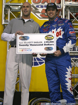 Drivers presentation: Elliott Sadler receives a check