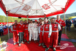 Sébastien Loeb and Daniel Elena pose with their crew