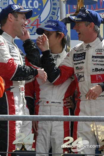 LM P1 podium: winners Tom Kristensen, Seiji Ara and Rinaldo Capello celebrate