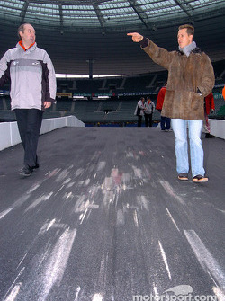 Michael Schumacher inspects the track with Marc Duez