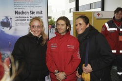 Two fans meet Jarno Trulli during Open Doors