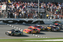 Under yellow: Tony Stewart takes the checkered flag ahead of Kevin Harvick, Dale Earnhardt Jr. and Martin Truex Jr.
