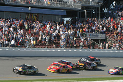 Under yellow: Tony Stewart approaches the checkered flag