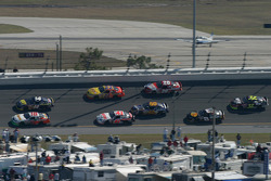 J.J. Yeley leads a group of cars