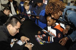 Mike Gallegas signs for future NASCAR fans during the Drive for diversity meet and greet