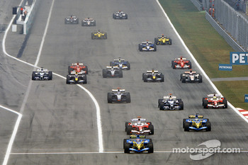 Fernando Alonso leads Jarno Trulli