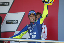 Podium: race winner Valentino Rossi celebrates