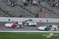 Martin Truex Jr. avoids Scott Pruett and flying cones