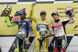 Podium: race winner Alex Barros with Valentino Rossi and Max Biaggi