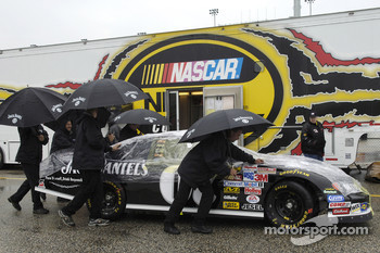 The #07 Jack Daniel's Chevrolet leaves inspection