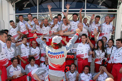 Jarno Trulli celebrates third place finish with Toyota team members