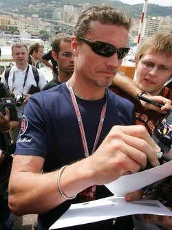 David Coulthard signs autographs