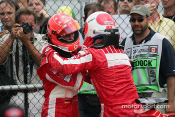 Michael Schumacher and Rubens Barrichello celebrate podium finish
