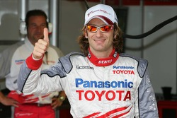 Pole winner Jarno Trulli celebrates