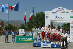 Podium: winners Sébastien Loeb and Daniel Elena with Toni Gardemeister and Jakke Honkanen, and Carlos Sainz and Marc Marti