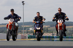 Vitantonio Liuzzi and Red Bull Racing team members on trial bikes