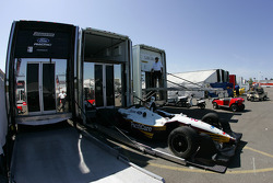 Newman Haas Racing crew members unload the cars