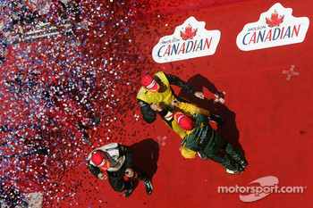 Podium: champagne for Justin Wilson, Oriol Servia and Alex Tagliani