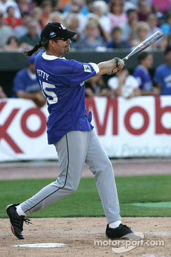 Kyle Petty takes a cut at the ball during the Racin' the Bases Celebrity Softball game benefitting the Victory Junction Gang Camp