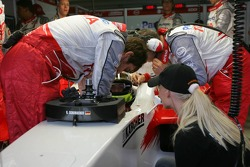 Cora Schumacher watches husband Ralf preparing for the race