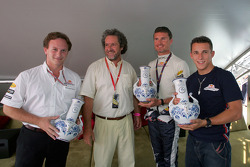 Christian Horner, David Coulthard and Christian Klien are presented with local pottery jugs to celebrate 20 years of Grand Prix racing in Hungary
