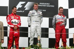 Podium: race winner Kimi Raikkonen with Michael Schumacher and Ralf Schumacher