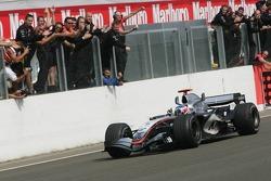 Kimi Raikkonen takes the checkered flag
