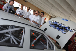 Ford officials and Wood Brothers crew members gather round the 2006 Ford Fusion
