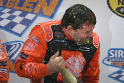 Victory lane: champagne shower for Tony Stewart