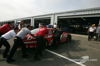 Bud Chevy crew members puch car to tech inspection