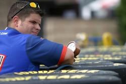 Brawny Dodge crew member prepares tires