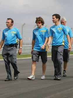 Fernando Alonso walks the track