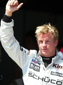 Pole winner Kimi Raikkonen celebrates